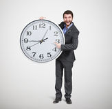 Man in formal wear pointing at clock Royalty Free Stock Photo