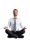 Man in formal wear practicing yoga Stock Images
