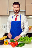 Man in formal wear preparing salad Royalty Free Stock Photography