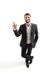 Man in formal wear waving his hand Royalty Free Stock Image