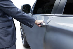 Man in formalwear opening a car door Royalty Free Stock Photography