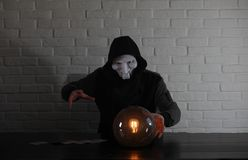 A man with a fortune teller ball. At the table stock photos