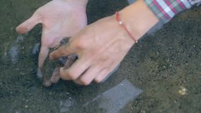 The man found gold. Contemporary lucky prospector found lot of gold in creek when panning sand. stock footage