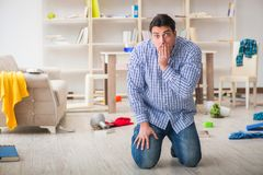The man found his house after burglary robbed by burglars. Man found his house after burglary robbed by burglars Stock Photography