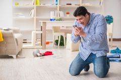 The man found his house after burglary robbed by burglars. Man found his house after burglary robbed by burglars Stock Image