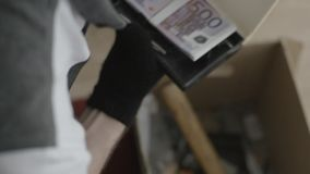 Man found the money in the box. Man is looking for something in a box.  stock video