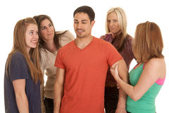 Man with four women around him Royalty Free Stock Photos