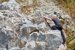 Man free climbing Stock Photos
