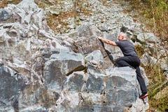 Man free climbing Stock Photos