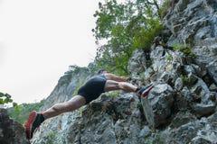 Man free climbing on mountain Stock Photos