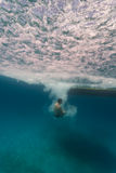 Man free diving from boat on coral reefs in Hol Ch Stock Image