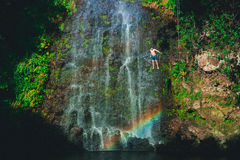 Man free jumping from waterfall Royalty Free Stock Photos