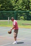 Man Free Throw prep. 40+ year old man preparing to make a free throw shot at the park royalty free stock photos