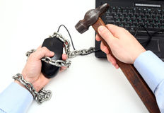 Man freed from the chain riveted to his computer and the virtual world. Stock Photos