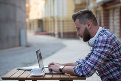 Man freelancer with laptop Stock Photography