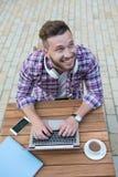 Man freelancer with laptop Stock Image