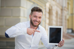Man freelancer with tablet PC royalty free stock photos