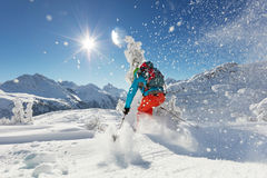 Man freerideer running downhill Stock Images
