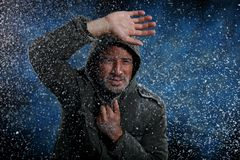 Man Freezing in Cold Weather. Dramatic Image of Scruffy Man Freezing in Cold Weather Royalty Free Stock Image