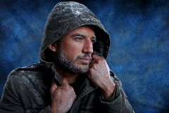 Man Freezing in Cold Weather. Dramatic Image of Scruffy Man Freezing in Cold Weather Stock Photos