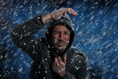 Man Freezing in Cold Weather. Dramatic Image of Scruffy Man Freezing in Cold Weather Royalty Free Stock Images