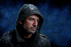 Man Freezing in Cold Weather. Dramatic Image of Scruffy Man Freezing in Cold Weather Stock Photography