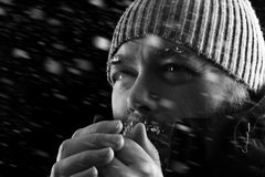 Man freezing in snow storm close up BW Stock Images