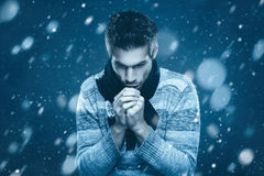 Man is freezing in the snow Stock Photos