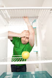 Man and fridge Stock Photo