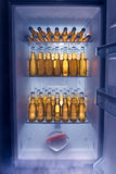 Man Fridge. Fridge full of cold beer with one lonely carrot Stock Images