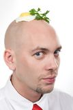 Man with fried egg Royalty Free Stock Photos