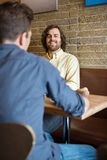 Man With Friend Sitting At Coffeeshop Royalty Free Stock Photos