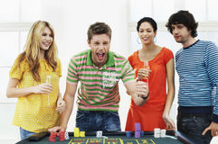 Man With Friends Celebrating Win At Roulette Table Stock Image