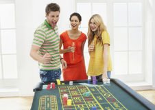 Man With Friends Celebrating Win At Roulette Table Stock Photography