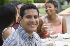 Man And Friends Celebrating With Wine Stock Photo