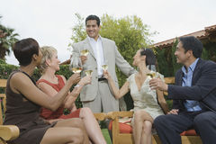 Man And Friends Celebrating With Wine Stock Photos