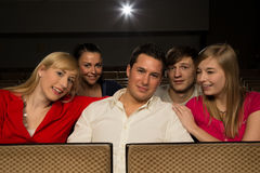 Man with friends in a cinema Stock Photo