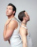 Man friendship. 2 mens on steel chain looking around stock image