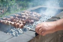 Man fries a shish kebab Stock Image