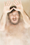 Man frightened in a shower royalty free stock images