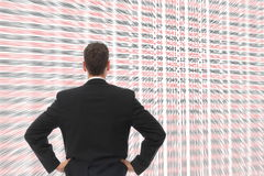 Man in front of a big screen with numbers Royalty Free Stock Photo