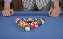 Man in front of the billiard balls Stock Photo