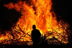 Man in front of a bonfire. Walpurgis Night bonfire in Sweden Stock Image
