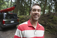Man In Front Of Car In Forest Royalty Free Stock Images