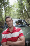 Man In Front Of Car In Forest Royalty Free Stock Photography