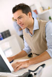 Man in front of desktop Stock Images