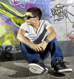 Man in front of graffiti wall Stock Photos