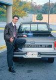 Man in front of his car Stock Photography