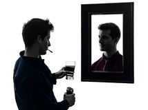 Man in front of his mirror silhouette Stock Image