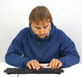 Man in front of the keyboard Stock Photos